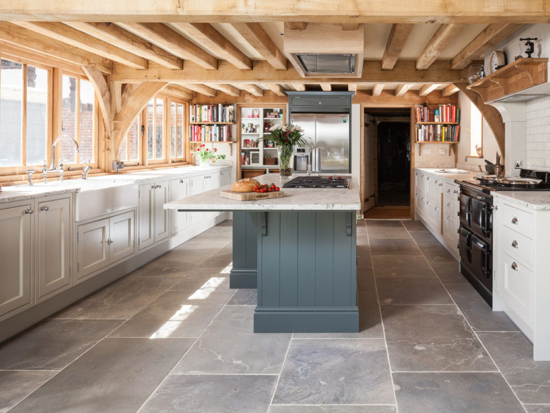 kitchen with beams tiled floors and island