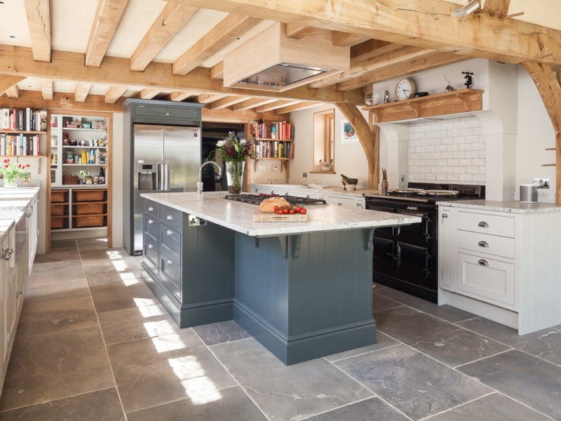 light filled kitchen extension with beams and tiled floor