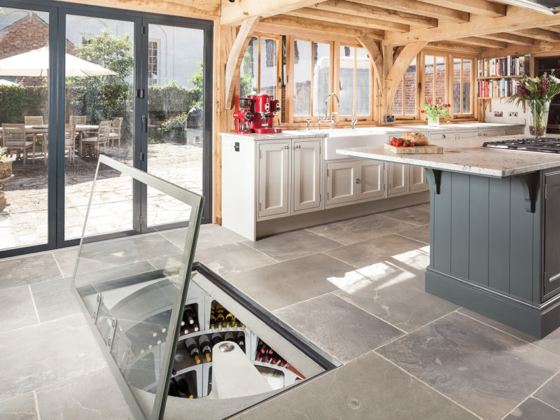 kitchen with bespoke submerged wine cellar