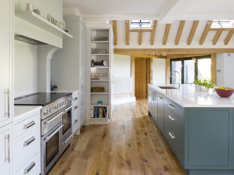 modern country kitchen with wood floor and range cooker
