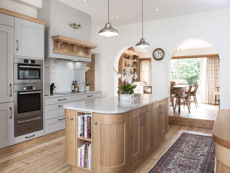 grey kitchen with wood floor and rug