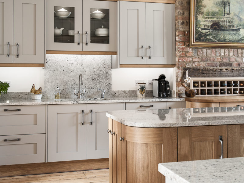 grey kitchen with granite worktops
