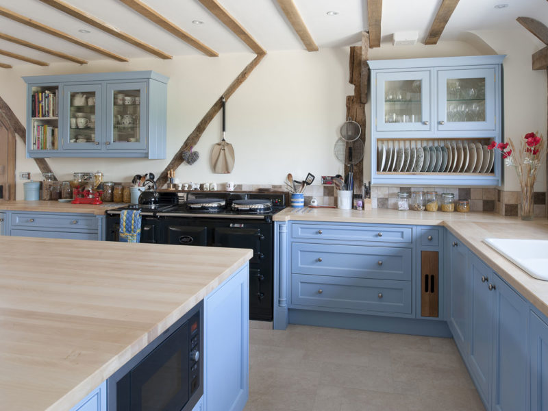 light blue kitchen with beams and island