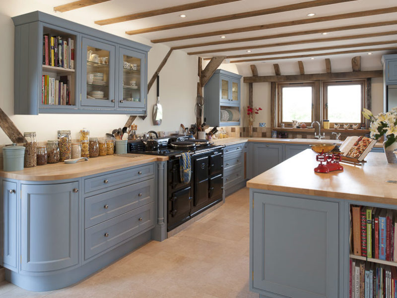 light blue kitchen with beams and storage