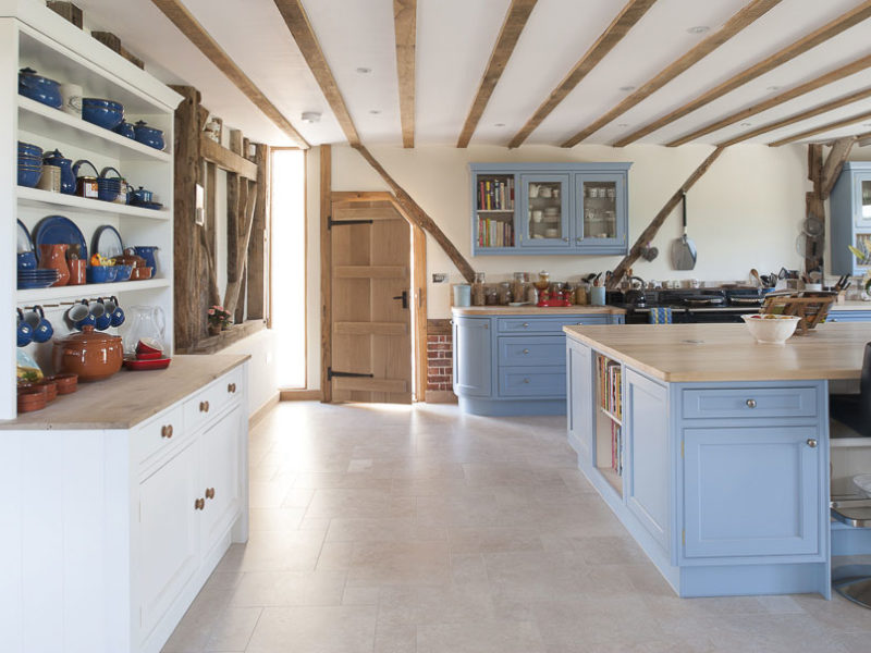 light blue kitchen with shelving unit and beams