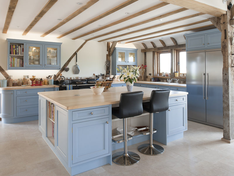 light blue kitchen with wood accents and tiled floor
