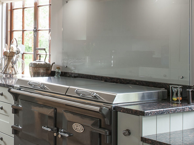 kitchen with range cooker and built in cooker hood