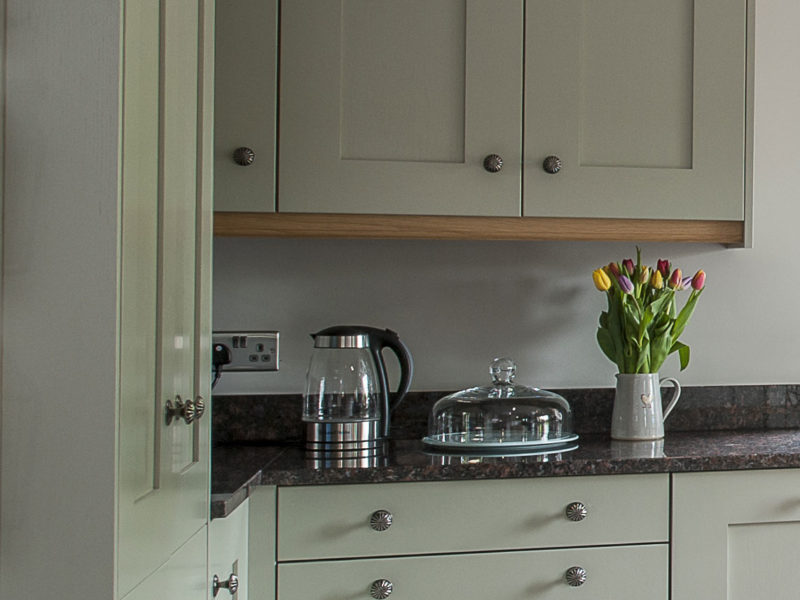 kitchen with kettle and flowers