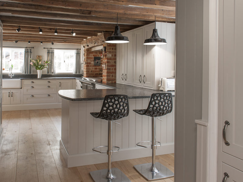 cottage kitchen with industrial metal barstools