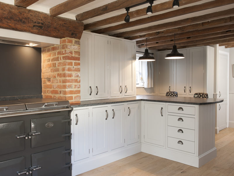 cottage kitchen with pendant lamps and range cooker