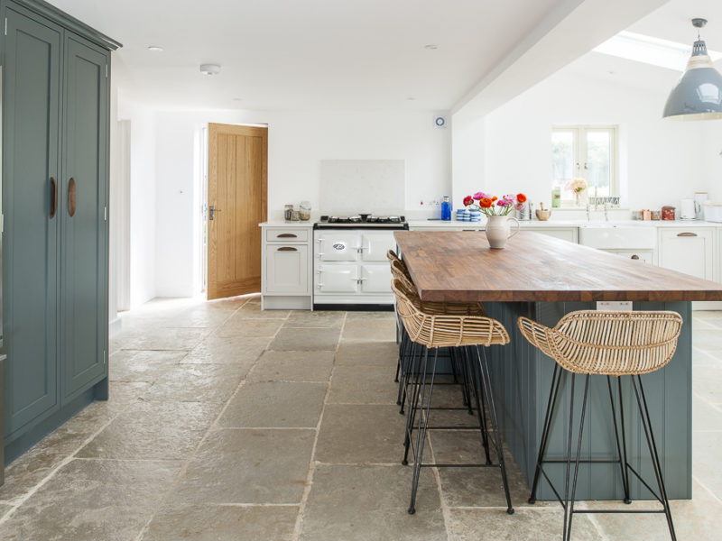 open kitchen with stone tiled floor and breakfast bar