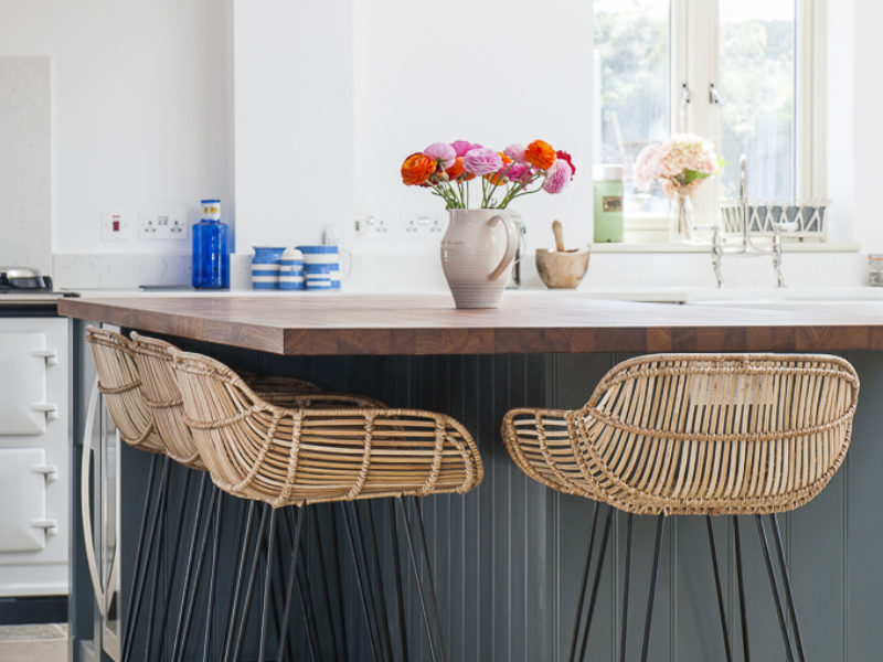 breakfast bar with woven barstools