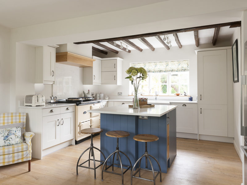 cottage kitchen with beams and blue island