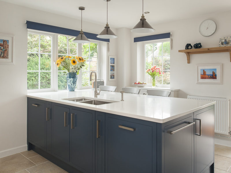 blue kitchen island with french windows
