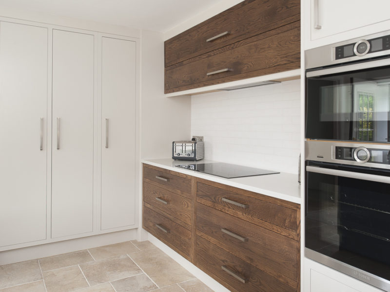 white kitchen with wood accents and tiled floor