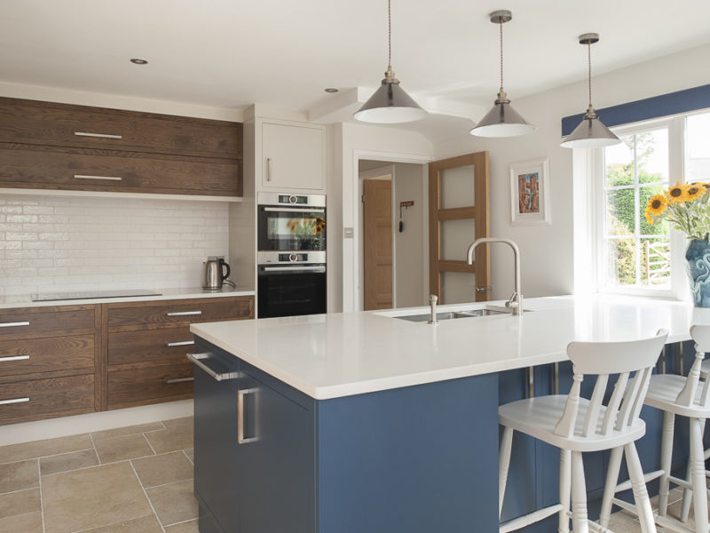 bespoke kitchen with blue island
