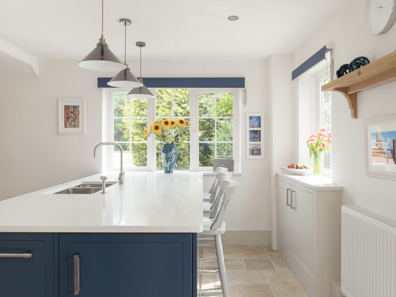 light and airy kitchen with blue island