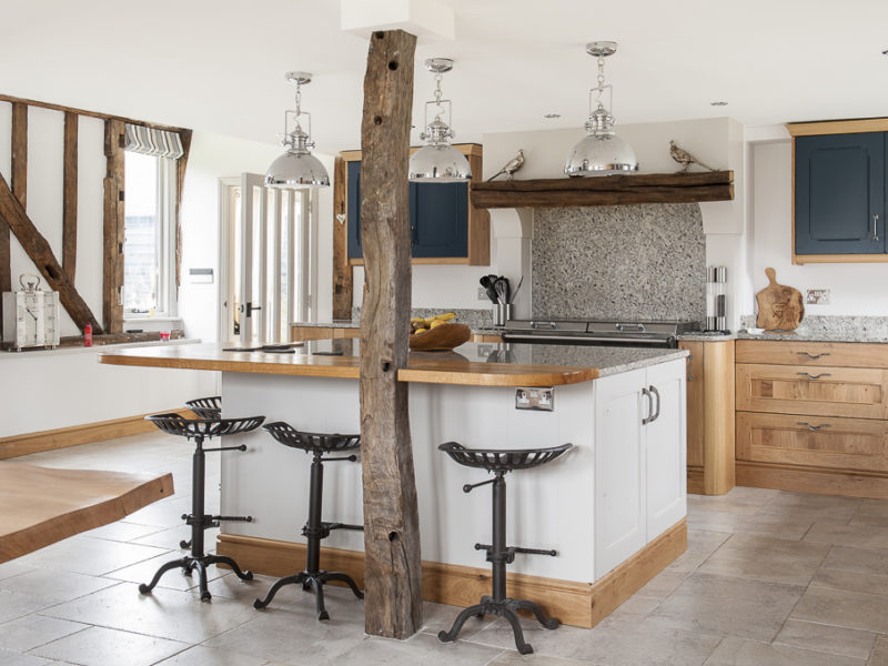kitchen with beams and tiled floor