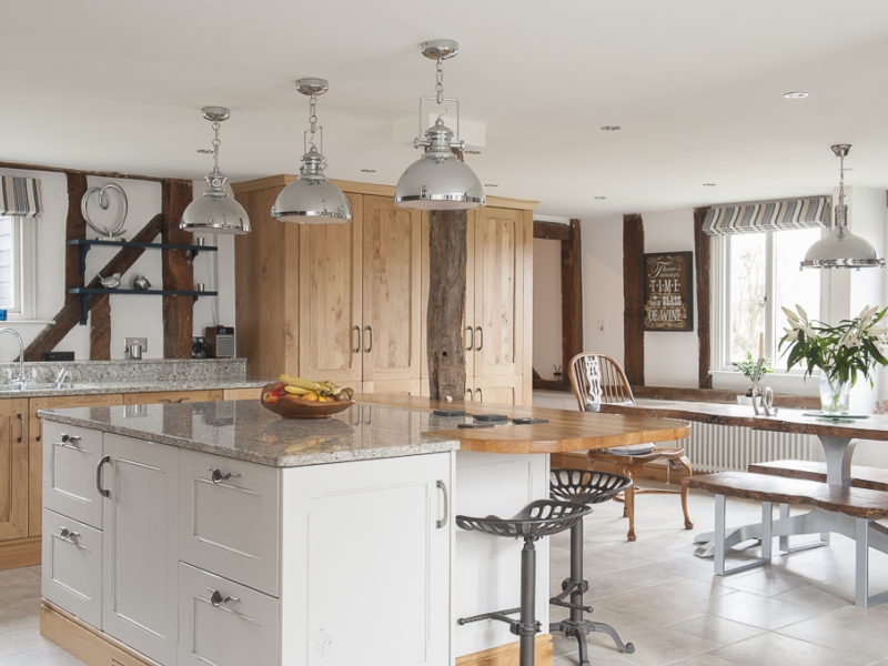 family kitchen with island and pendant lamps