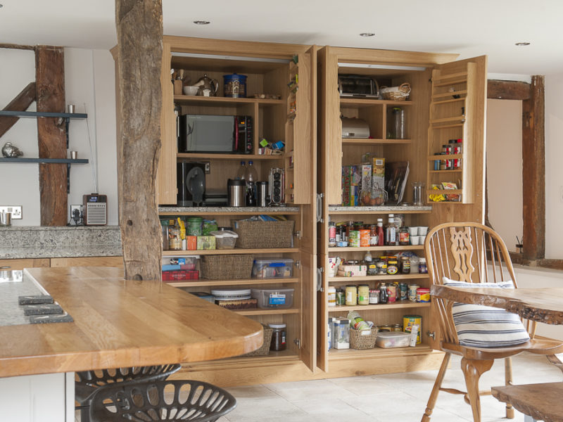 wood kitchen with shelving and dining table