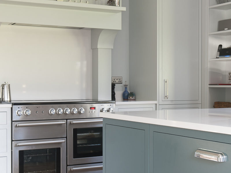 modern country kitchen with blue island and range cooker