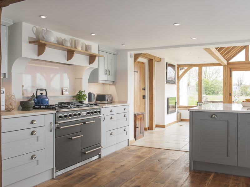 farmhouse kitchen with wood floor and range cooker