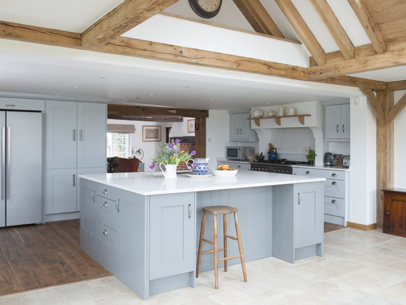 farmhouse kitchen with island and beams