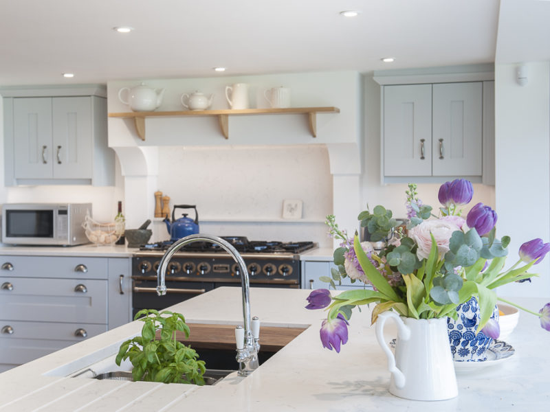 farmhouse kitchwn with swan neck tap and flowers