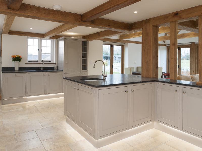 grey kitchen with beams and tiled floor