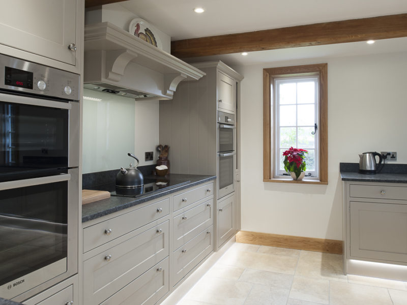 classic grey kitchen with tiled floor and window