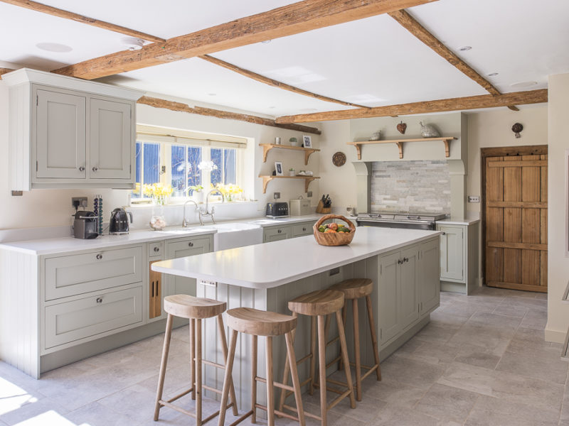 charming farmhouse kitchen with beams and island