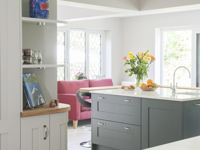 grey kitchen with tiled floor and shelving