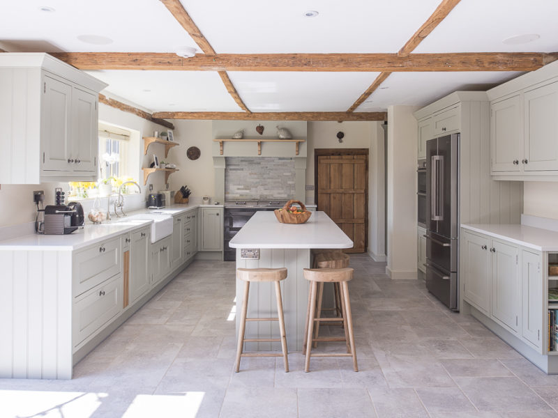 farmhouse kitchen with beams and breakfast bar