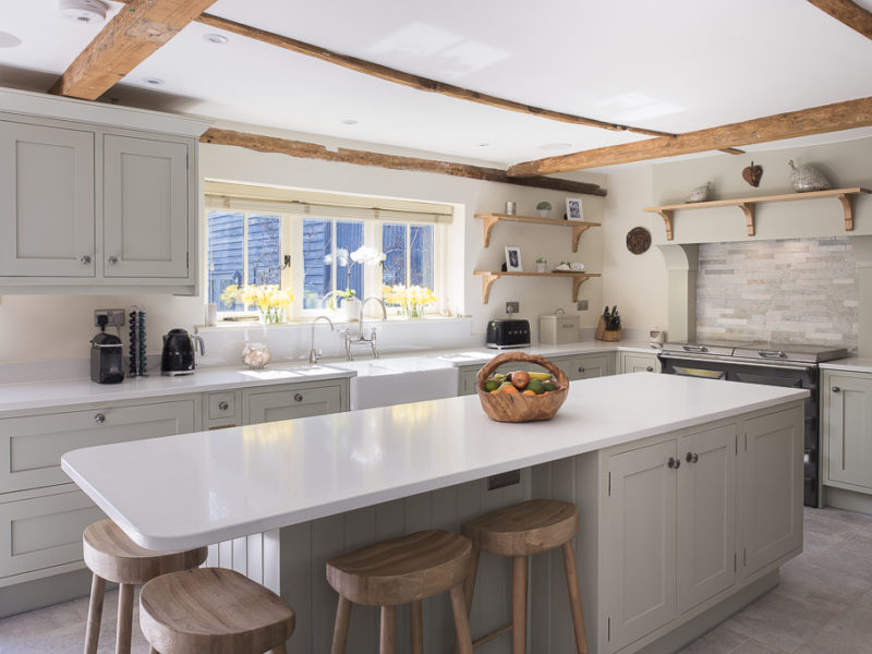farmhouse kitchen with windows and breakfast bar
