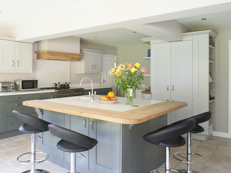 grey kitchen island with breakfast bar