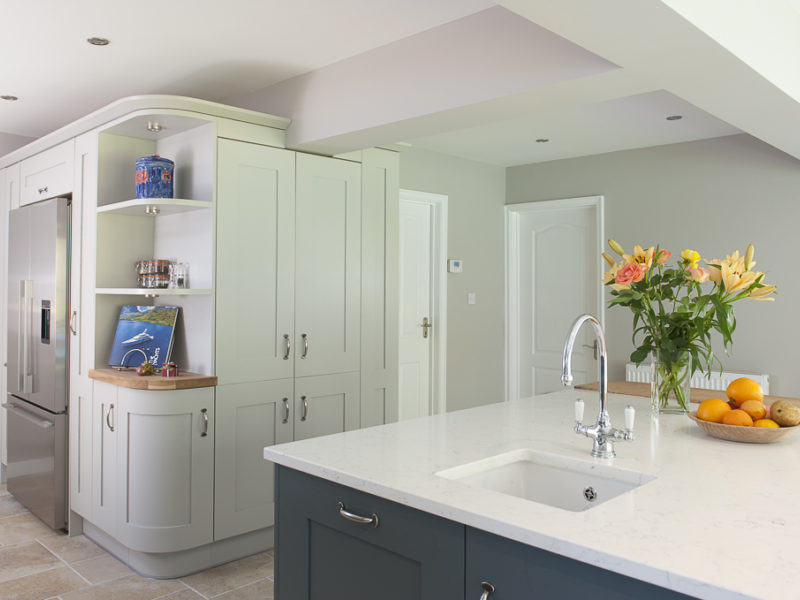 sophisicated grey kitchen with flowers