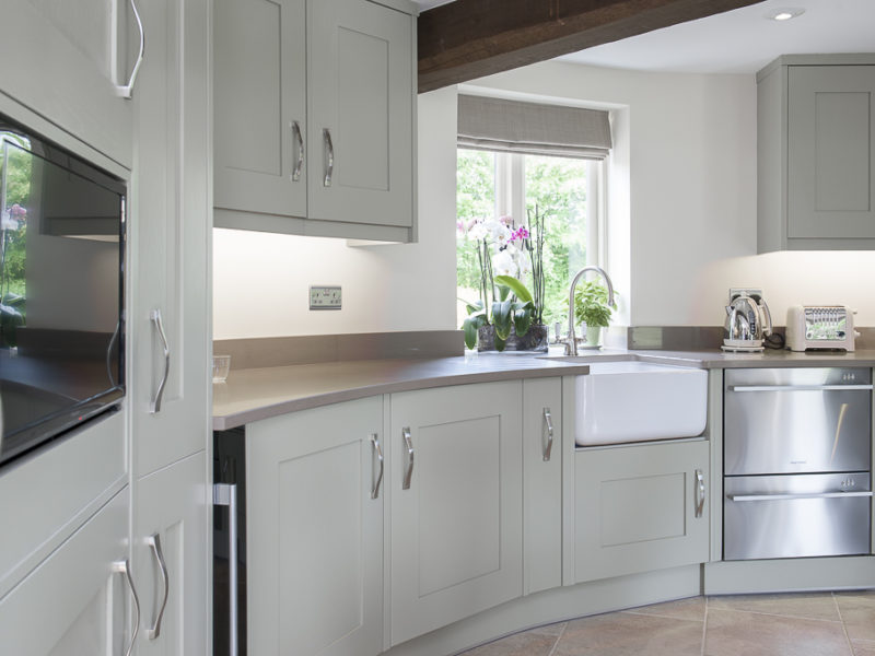unusual grey round kitchen with belfast sink