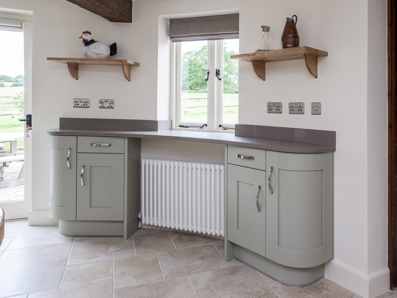 grey round kitchen with wood shelving