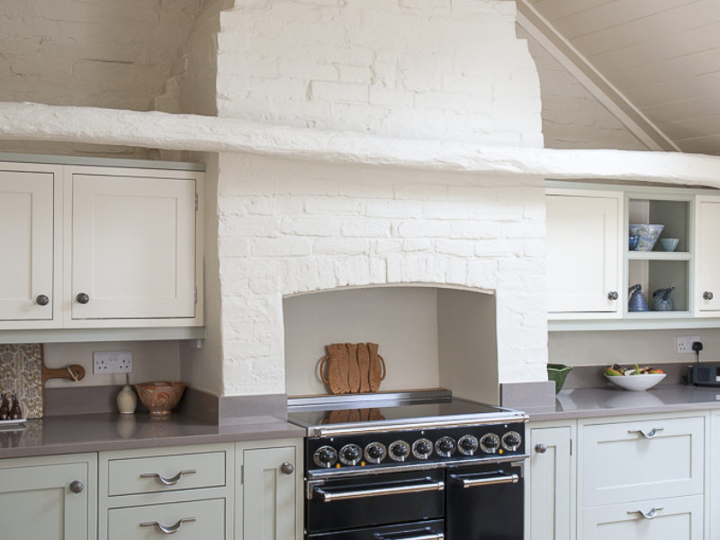 former bakery kitchen with feature brick chimney