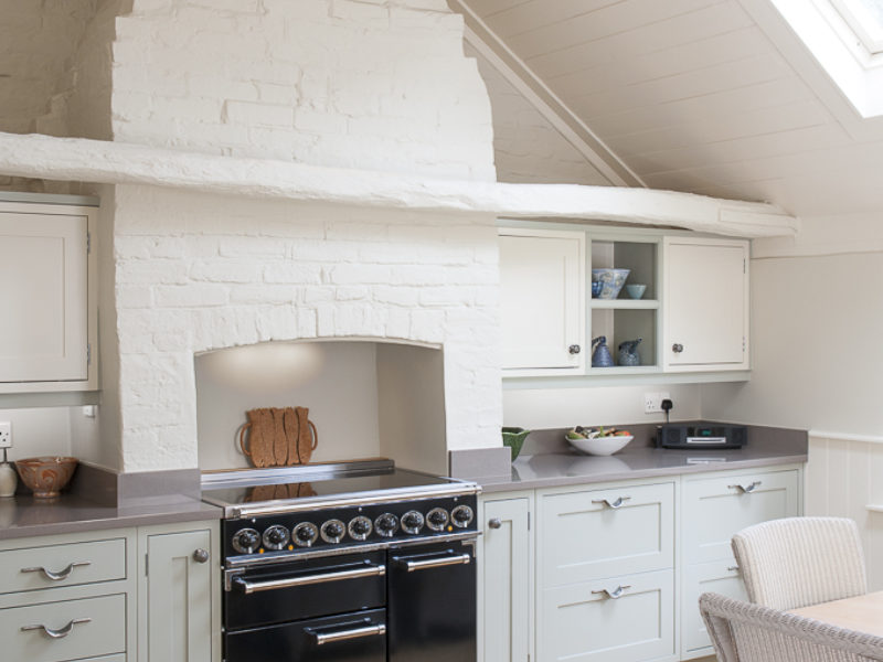 light and airy kitchen with wood floors and range cooker