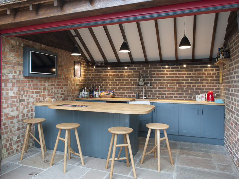 blue outside bar with beams and barstools