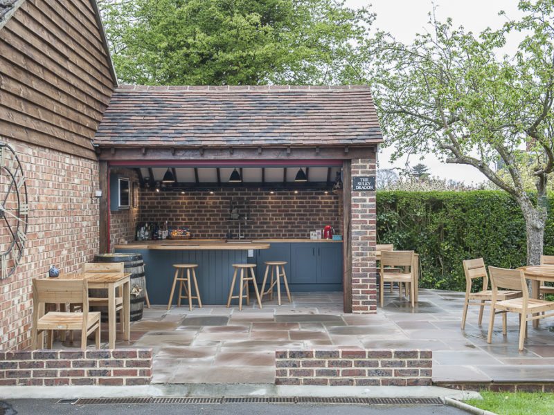 bespoke outside bar with beams and barstools