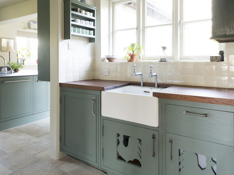 green kitchen with belfast sink