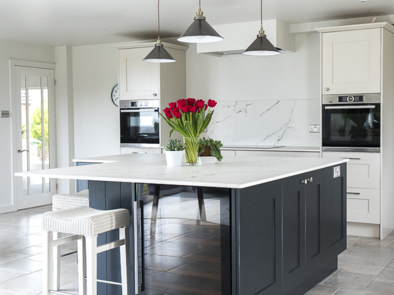 monochrome kitchen island with white stool