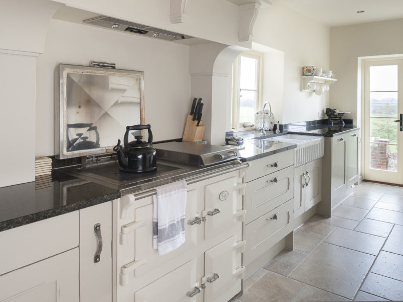 galley kitchen with range cooker and tiled floor