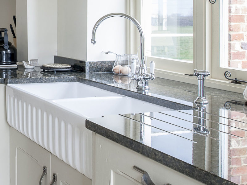 galley kitchen with swan neck tap and belfast sink