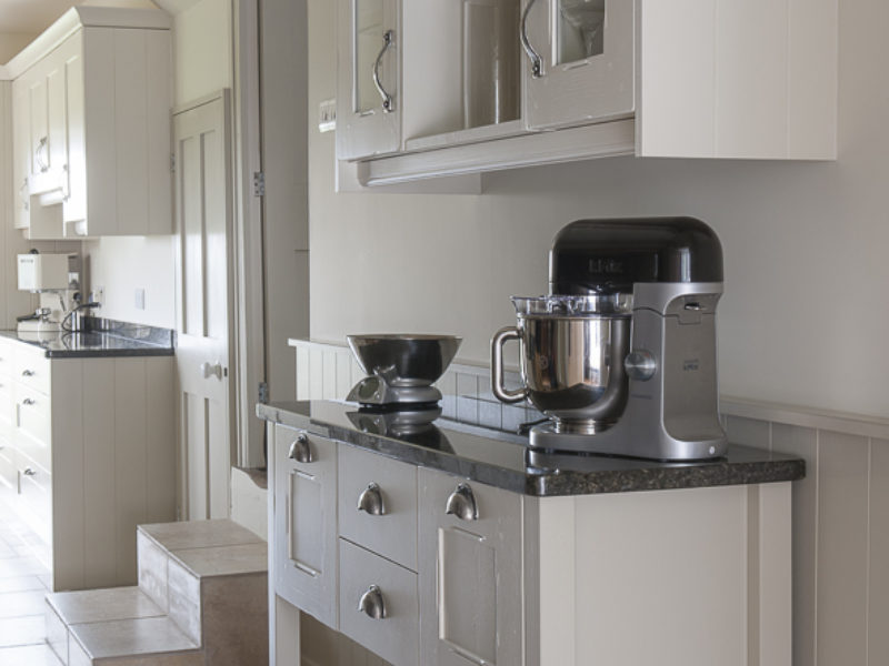 galley kitchen with freestanding storage