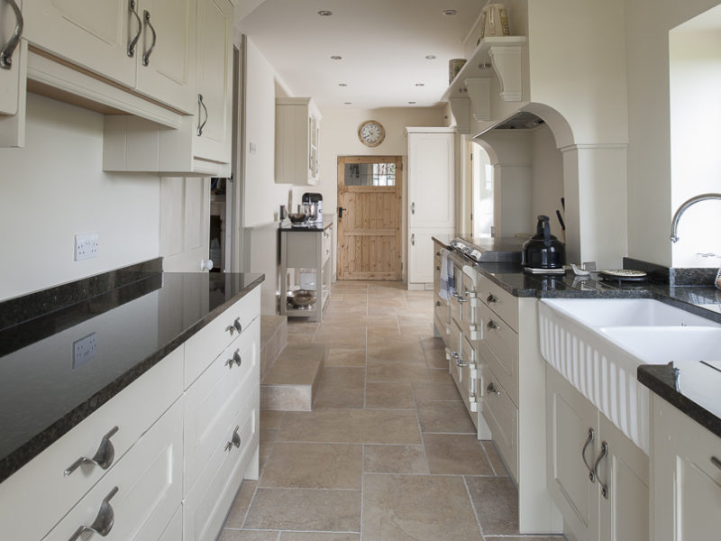 classic galley kitchen with tiled floor